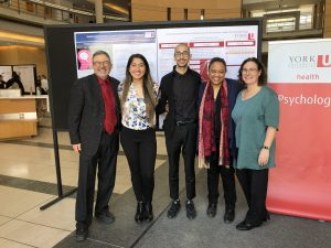 Poster Day willers photo. Left to right: Dr. Joel Goldberg ( Chair of Psycgology department),Shayan Asadi,Amina Yousaf,Dr. M. Herbert and Dr. Jill Rich (Poster day Coordinator)